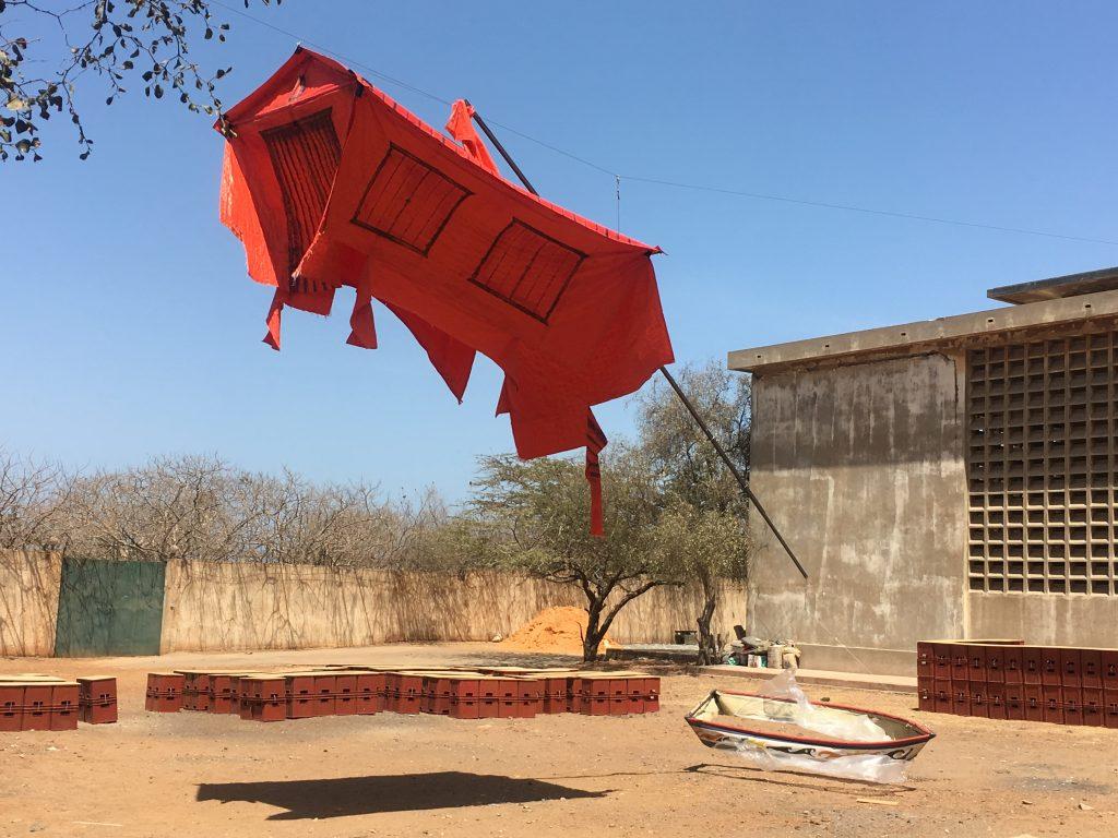 "Marcos Lora Read (Dominican Republic), La Casa Roja de Caronte, 2018. Installation view, Dak'Art Biennale 2018 ""The Red Hour/A New Humanity"" curated by Simon Njami. Photo credit: The Sole Adventurer."