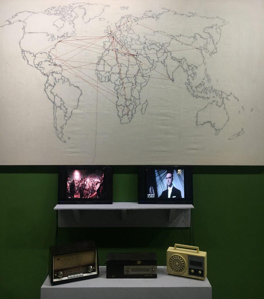 "Jihan El Tahri, Diaspora FM, 2018. Installation detail, Dak'Art Biennale 2018 ""Long Green Lizards/Family Function"" curated by Cosmin Costinas/Inti Guerrero/Sumesh Sharma. Photo credit: The Sole Adventurer."