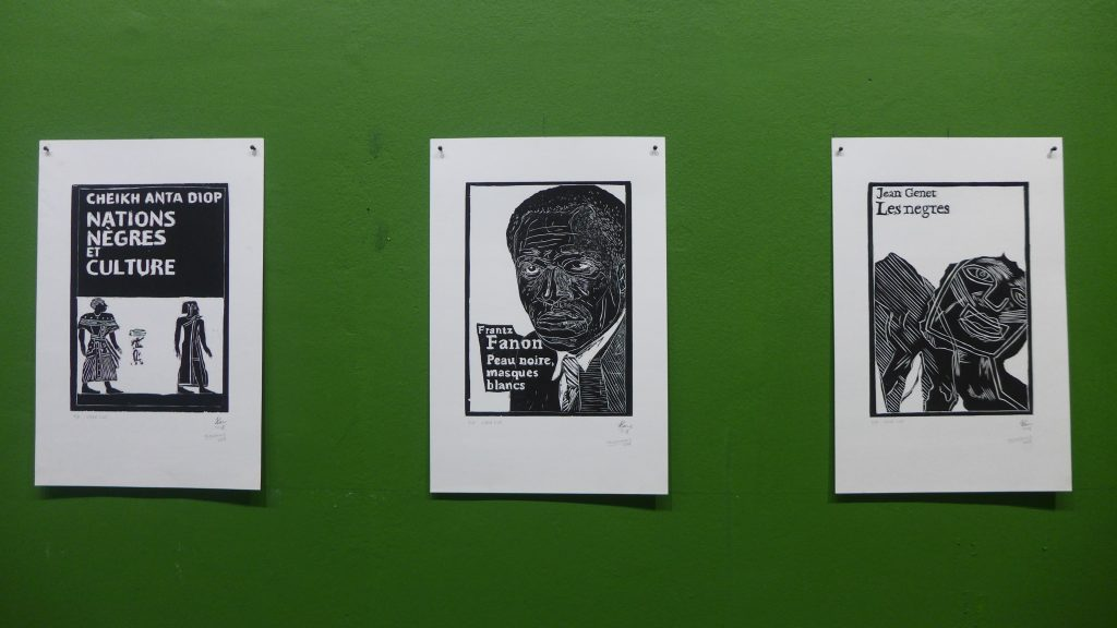 "Hamedine Kane and Tejswini Sonawane, Salesman of Revolt, prints, 2018. Installation detail, Dak'Art Biennale 2018 ""Long Green Lizards/Family Function"" curated by Cosmin Costinas/Inti Guerrero/Sumesh Sharma. Photo credit: The Sole Adventurer."