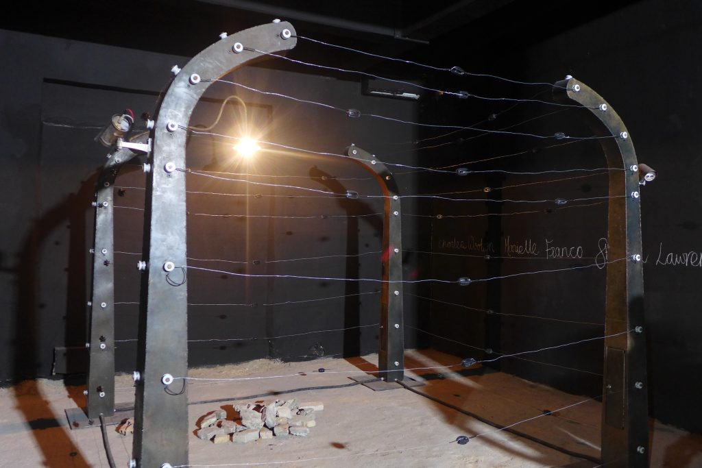 "Annabel McCourt & Wanja Kimani, The Electric Fence. Installation view, ""La cloche des fourmis"" organized by Laboratoire Agit'Art. Photo credit: The Sole Adventurer."