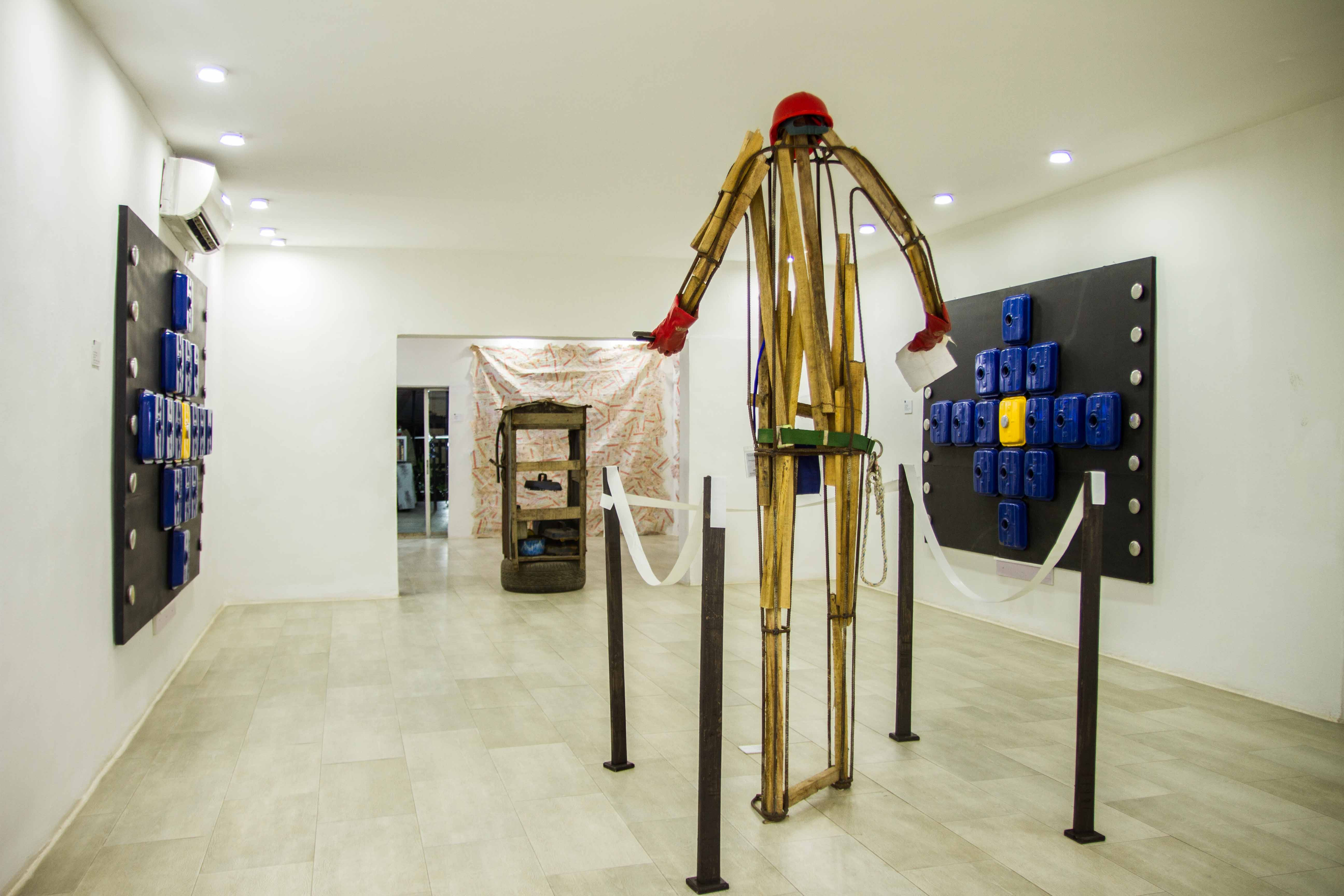Ayo Akinwande, Power Show Exhibition at Omenka Gallery, 2018. Installation view of works: (left) Open and Close I, (middle) Oga Ade, (right) Open and Close II, (in the entryway) Power House. Courtesy Ayo Akinwande
