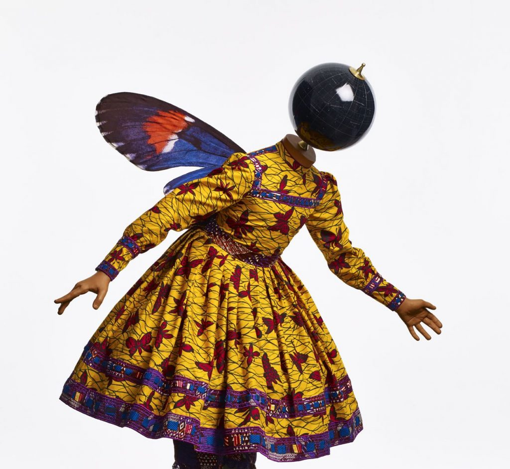 Yinka Shonibare, Butterfly Kid (girl), 2015, fibreglass mannequin, Dutch wax printed cotton textile, silk, metal, globe, and steel baseplate. Source: jamescohen.com