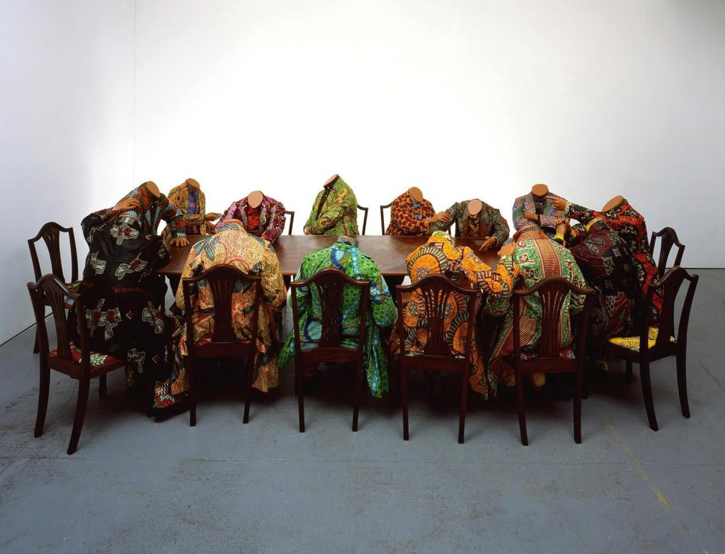 Yinka Shonibare, Scramble for Africa, 2003, 14 life-size fibreglass mannequins, 14 chairs, table, Dutch wax printed cotton. Source: Africa.si.edu