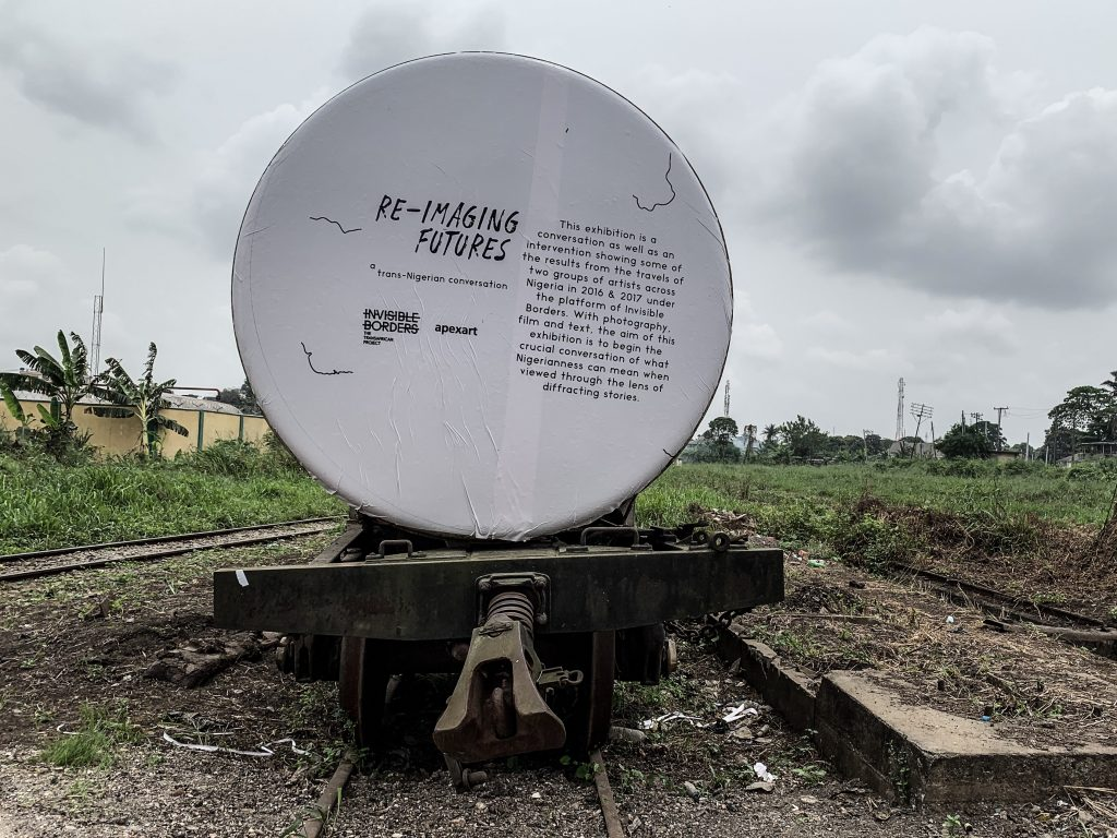 Re-imaging Futures: A Trans-Nigerian Conversation exhibition by Innocent Ekejiuba and Yinka Elujoba of Invisible Borders at the Nigerian Railway Corporation yard, Lagos. Image credit: Emeka Okereke