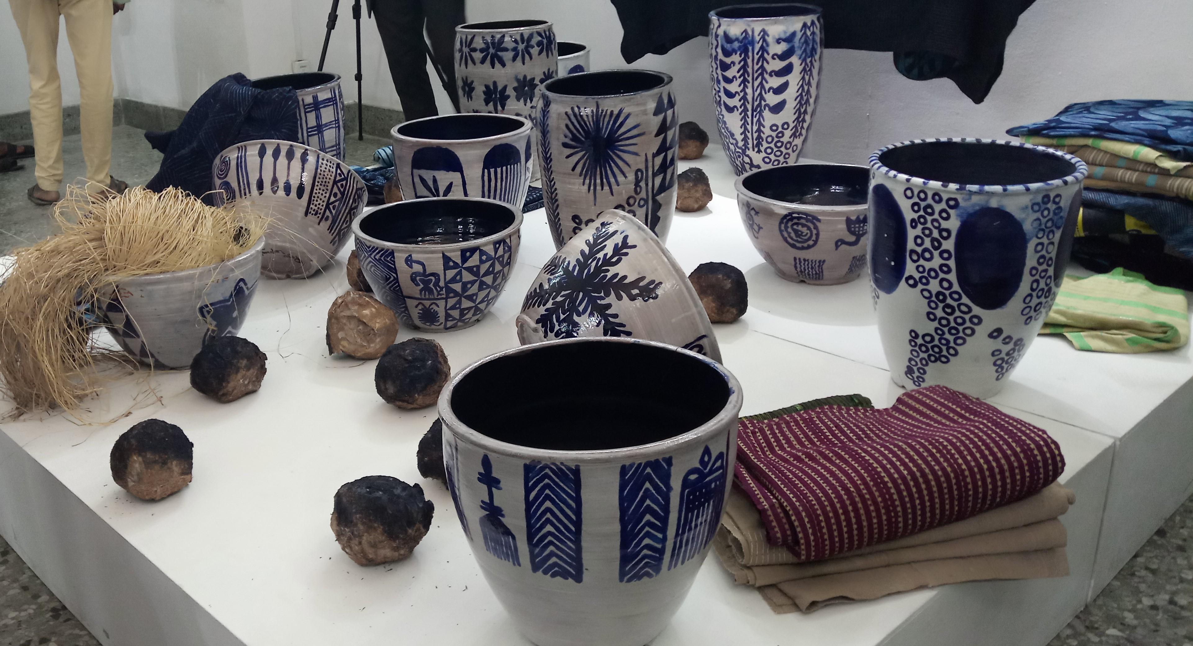 Peju Layiwola, Bringing in the Sheaves (2018-2019), Glazed Pots, Raffia, Aso-Oke. Courtesy Adekemi Kindehinbu