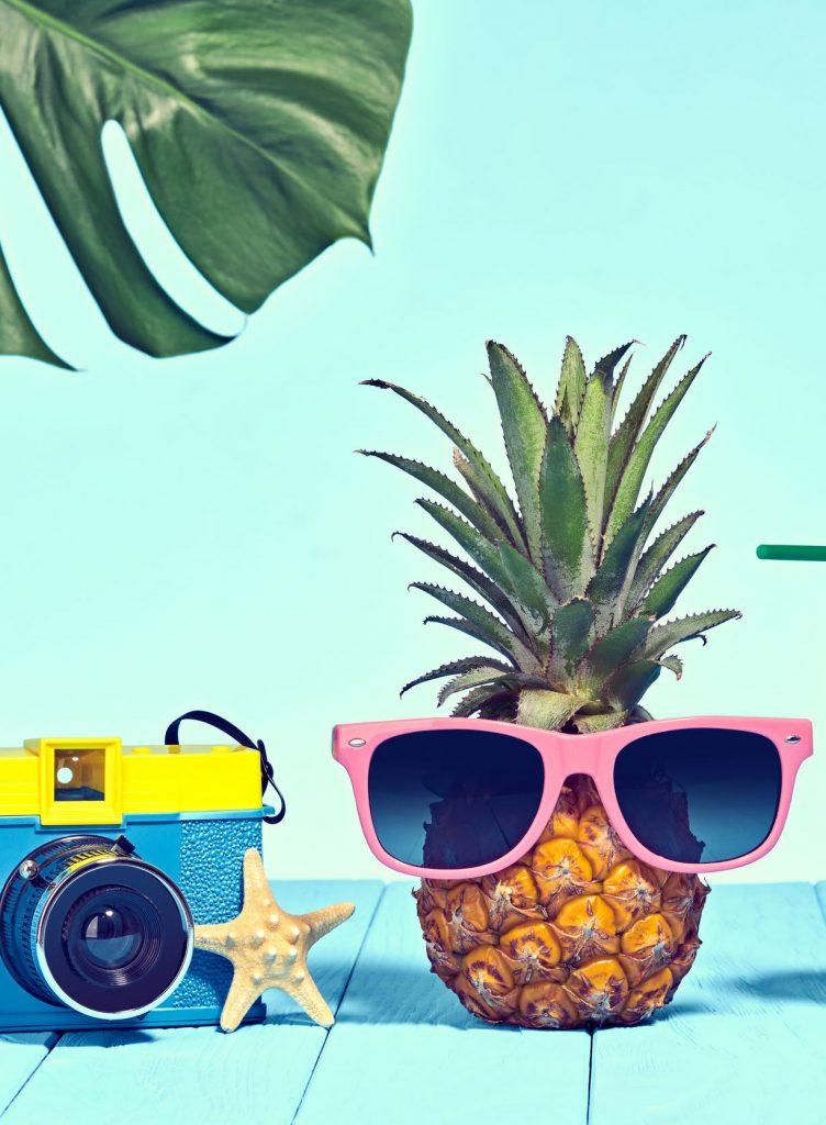 Hipster Pineapple in Trendy Sunglasses, Cocktail on Beach. Tropical Pineapple Fruit. Bright Summer Color. Minimal Art. Fun Summer party Mood. Retro Design camera TSA Art Magazine