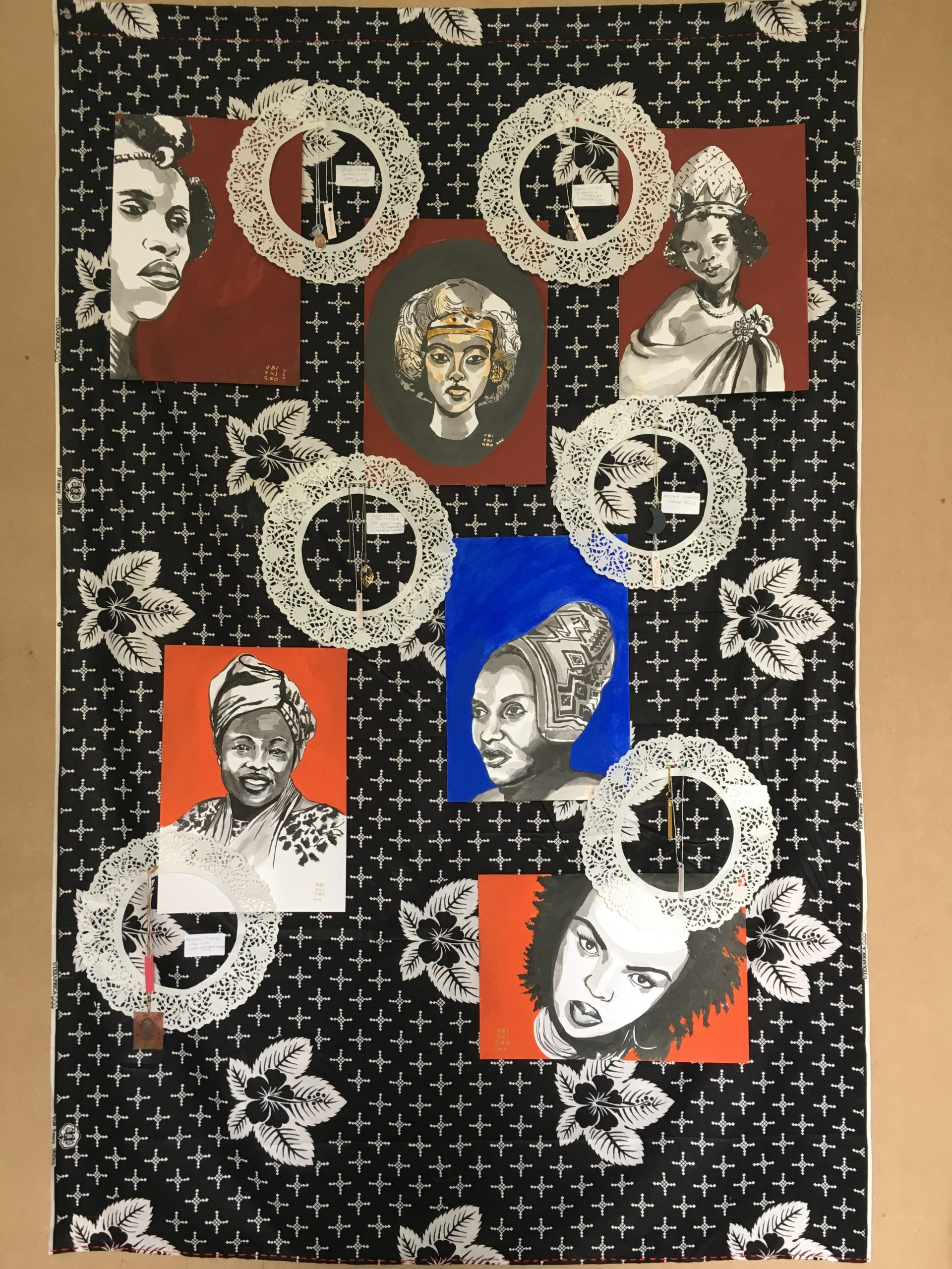 Obi Okigbo, MYSTIC LAMB Panel #4. SHEROES (Installation) Ink portraits, paper doilies, personal artefacts on cotton. Courtesy of the artist