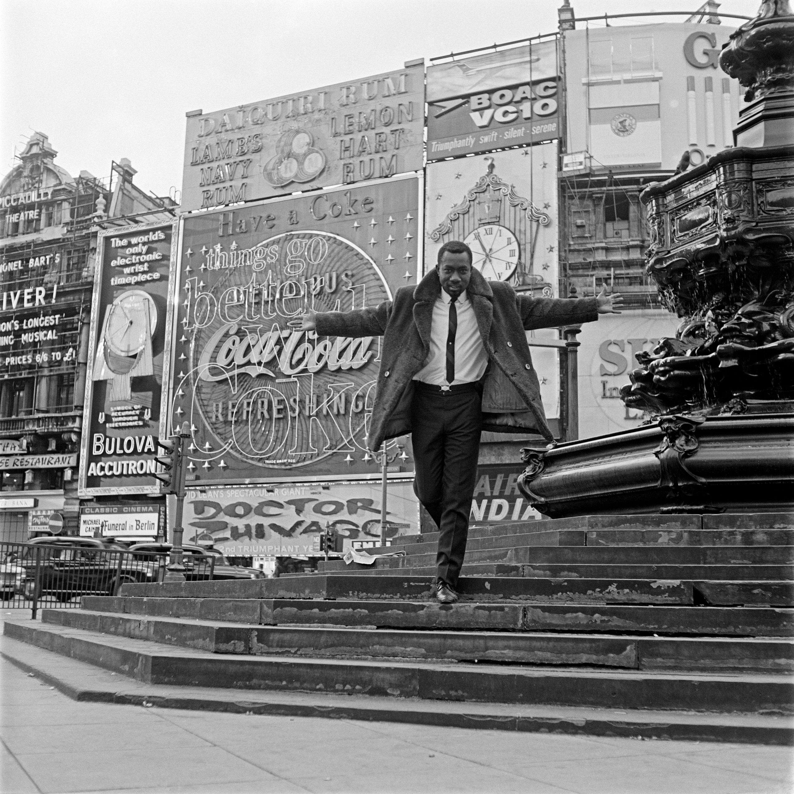 Date: 1967 Caption: Mike Eghan at Piccadilly Circus, London.