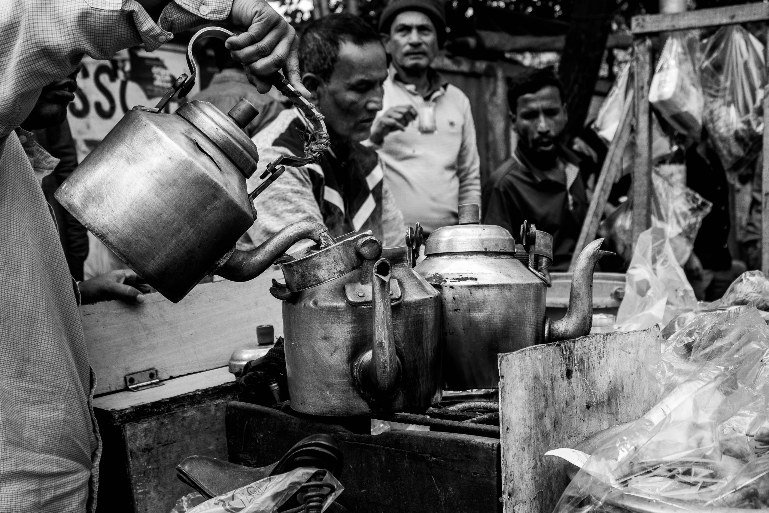 Photo: Chai. Image of kettles and men pouring chai