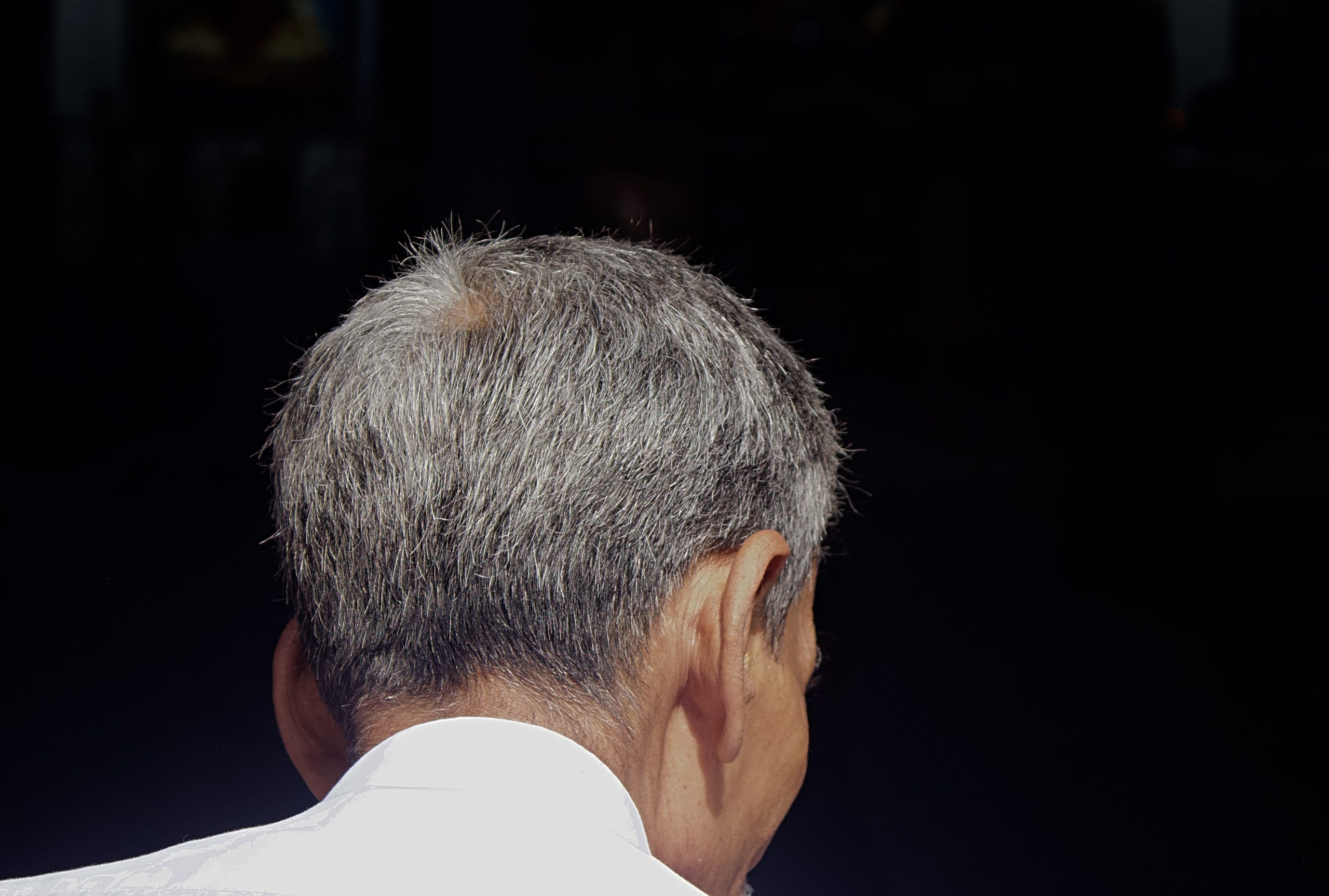 Photo: Say a Prayer. Image of a man's head taken from behind